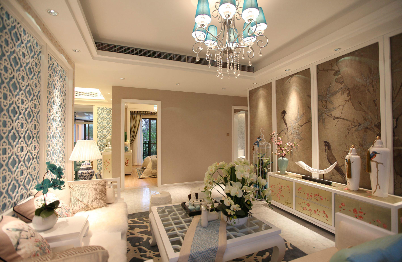 客厅中放置着以白色软包为设计的沙发,使整个空间在延伸的同时,更有着现代的时尚感
