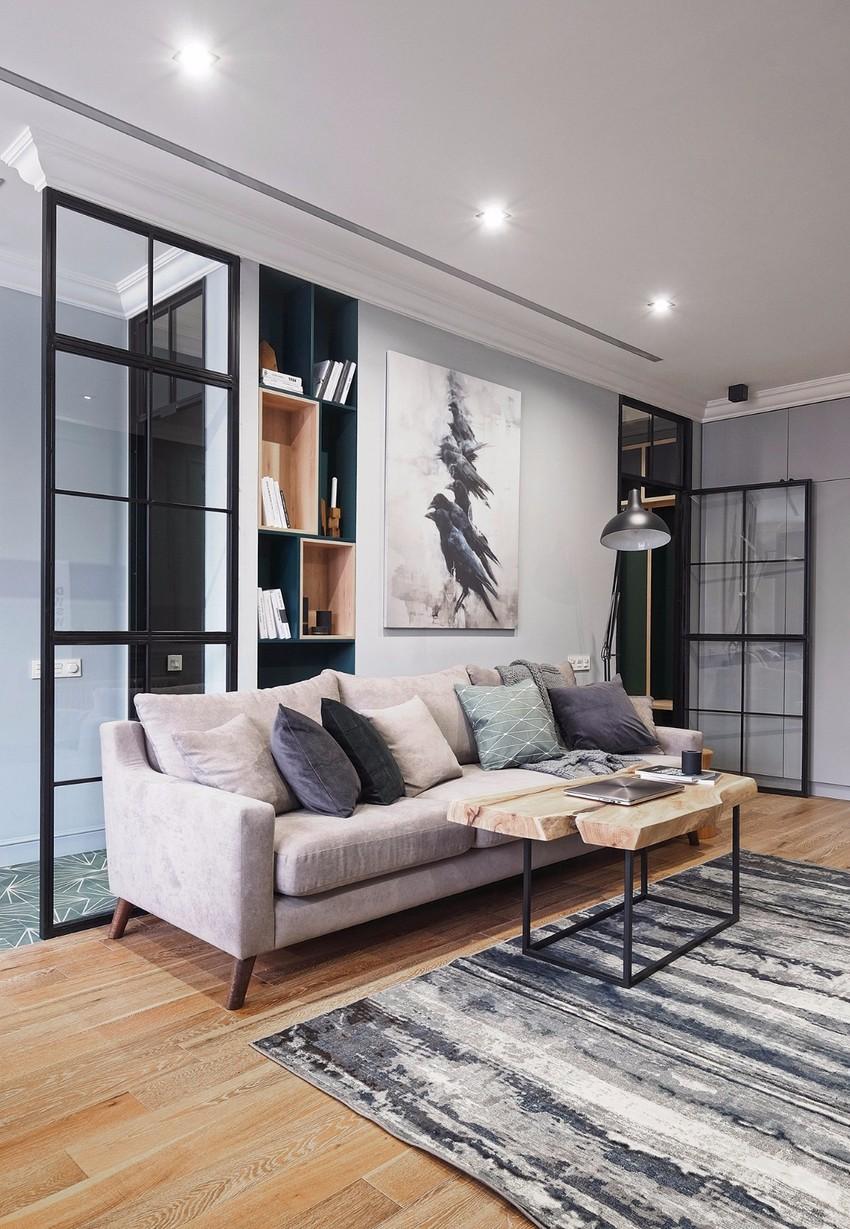 浅咖色绒布沙发触感柔软,造型简洁,颜色与整体风格很搭。