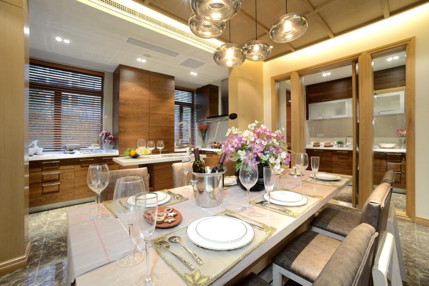 美式田园风格的设计中,厨房、餐厅大多是开放式的。厨房内忙碌着的身影成就了一个家的幸福。