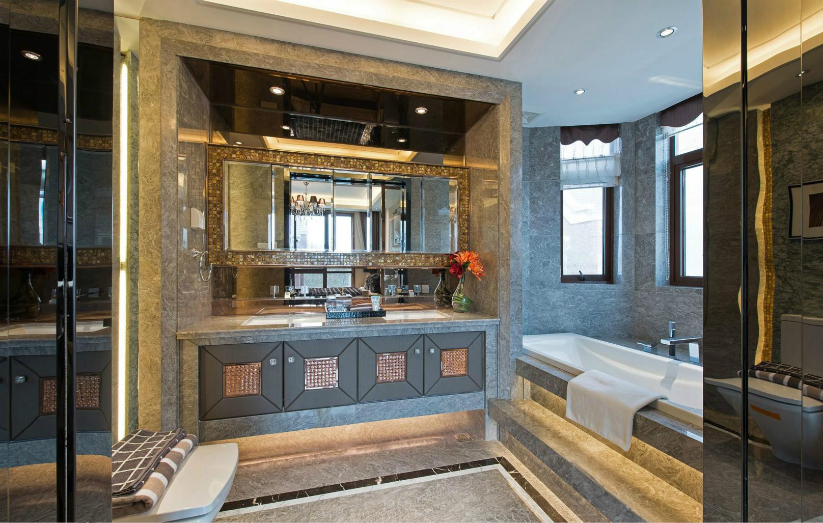 卫生间洗手台背景墙砖巧妙的设计,感觉很温暖很有情调。